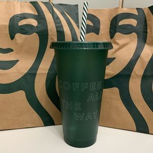 Starbucks tumbler in green with striped straw